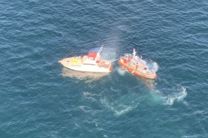 Coast Guard Rescues 3 from Burning Sportfisher
