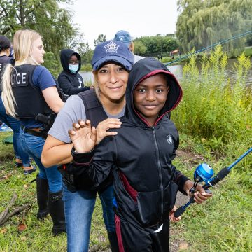 Chicago Police, Firefighters Help Youths Catch Their First Fish